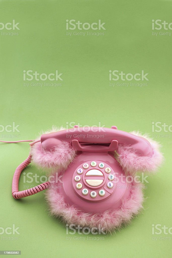 Pink phone on green background royalty-free stock photo