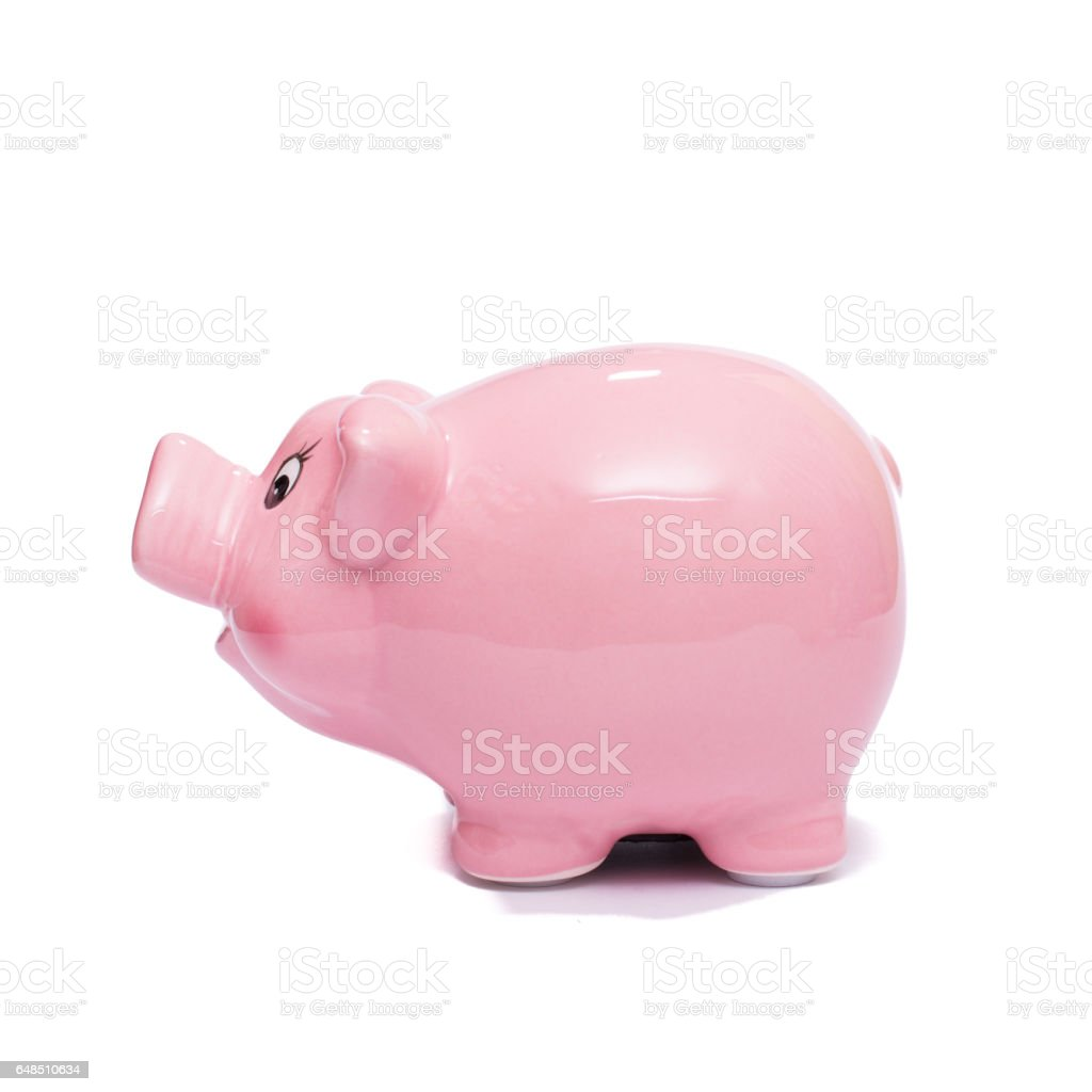 Pink piggy bank askance stock photo