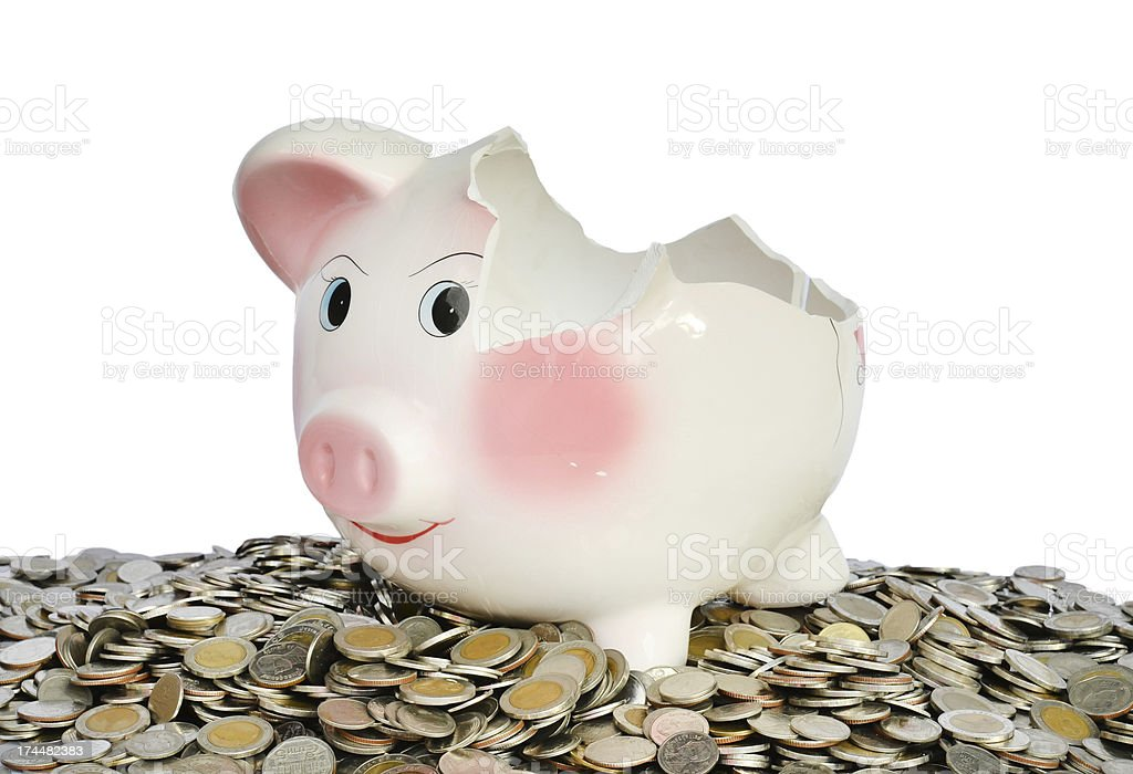 Pink piggy bank broken with money royalty-free stock photo