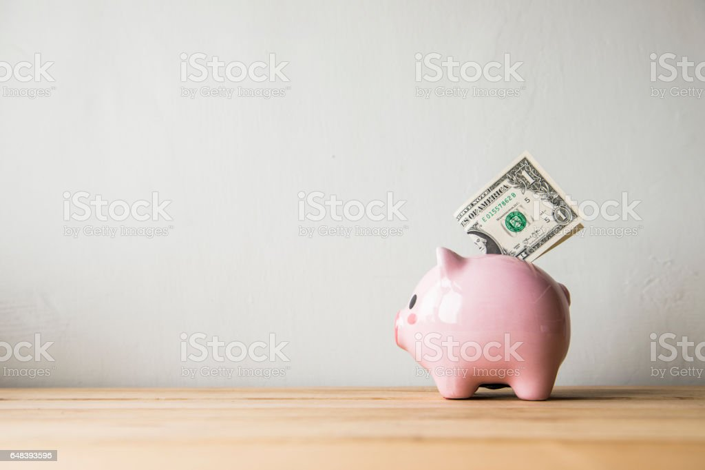Pink piggy bank on a white background stock photo