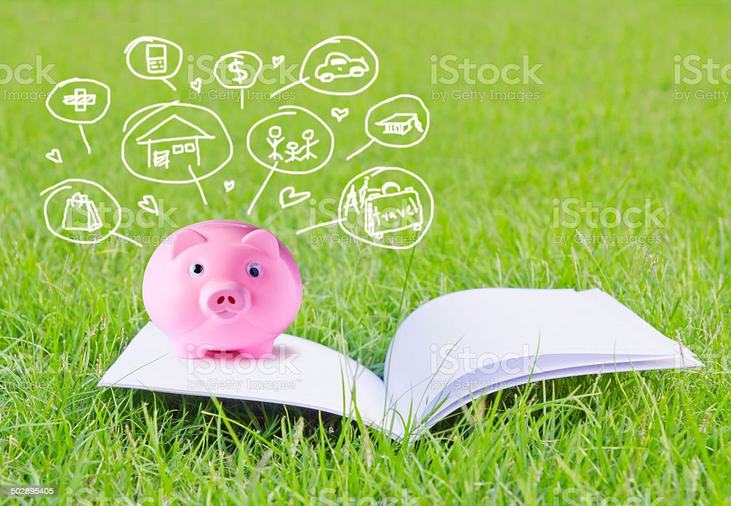 Pink piggy bank on booklet and icon design stock photo