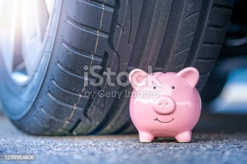 Conceptual photo for savings related to driving the car, mileage, tax, tire purchase, insurance, car maintenance, auto repair shop, price comparison