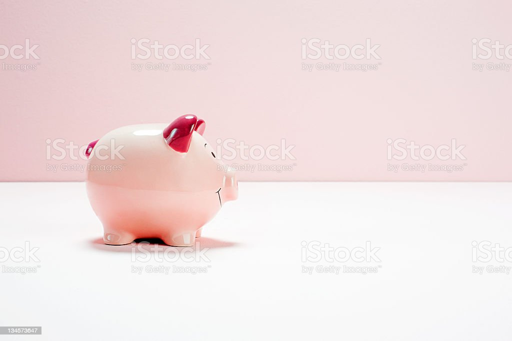 Pink piggy bank, studio shot stock photo