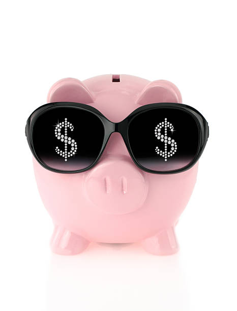 46646265e680 Pink piggy bank with cool money symbol sunglasses stock photo