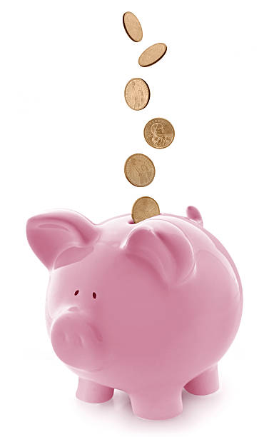Pink Piggy Bank with Falling Gold Coins stock photo
