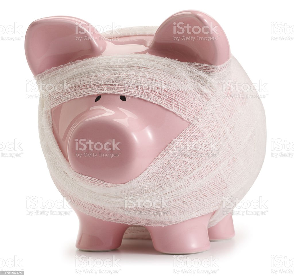 Pink piggy bank wrapped in gauze bandages on white background royalty-free stock photo