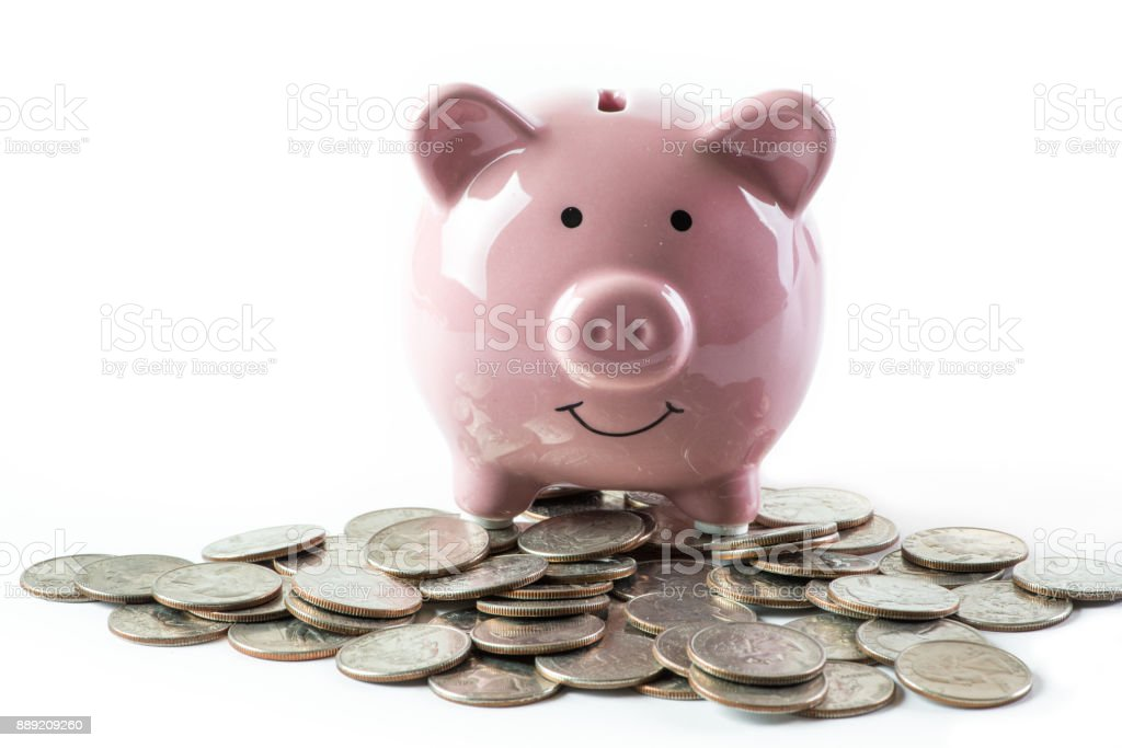 Pink Piggybank on Pile of Coins stock photo