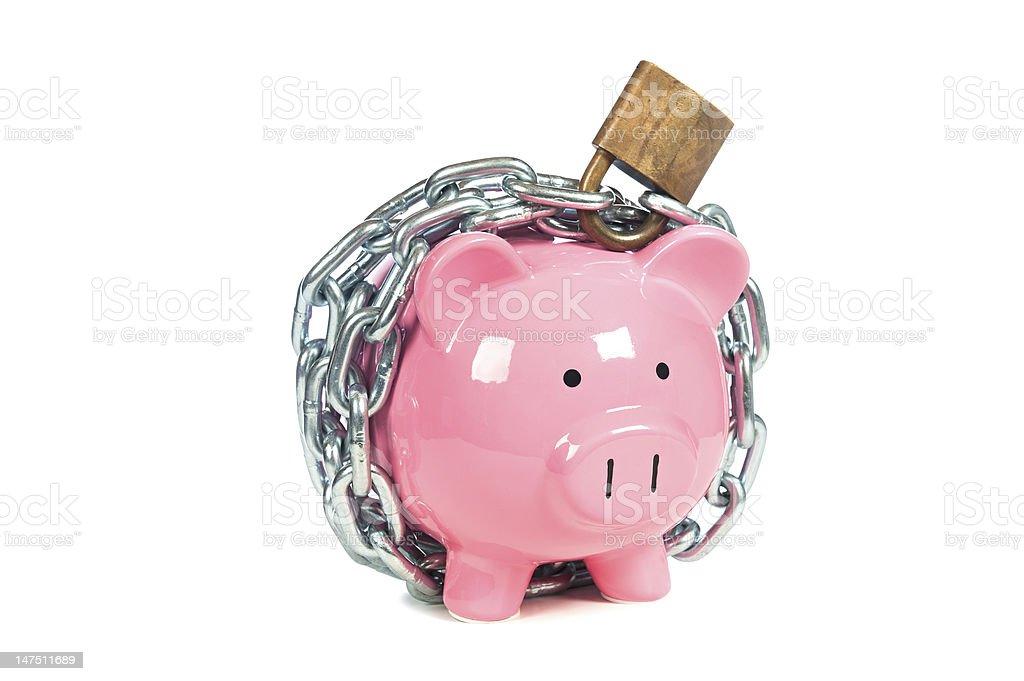 Pink piggybank with a padlock around it stock photo