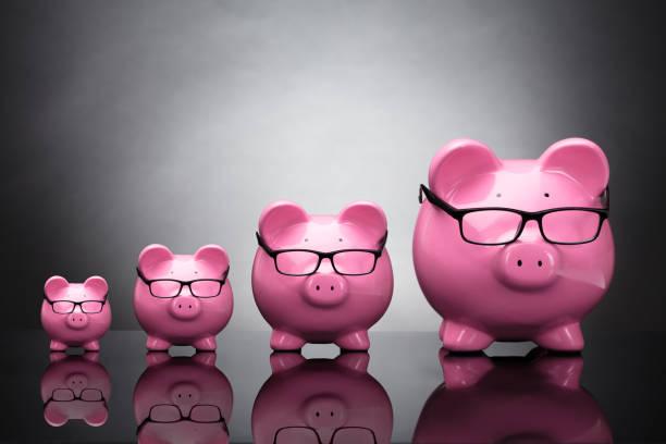 Pink Piggybanks Wearing Eyeglasses stock photo