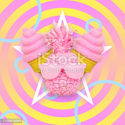 1125575814 istock photo pink pineapple fruit with sunglasses and two ice creams 1125575563