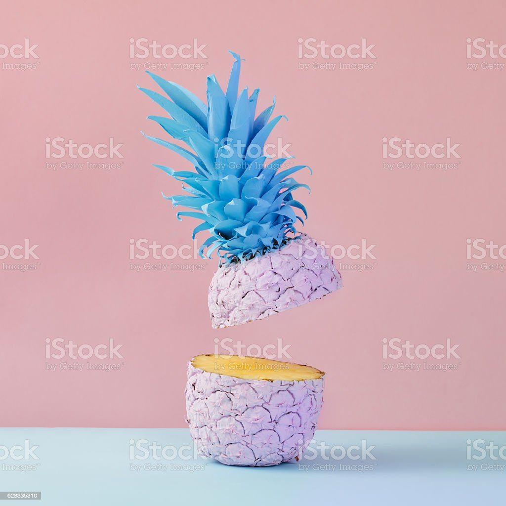 Pink pineapple on yellow background. Minimal style. Food concept stock photo
