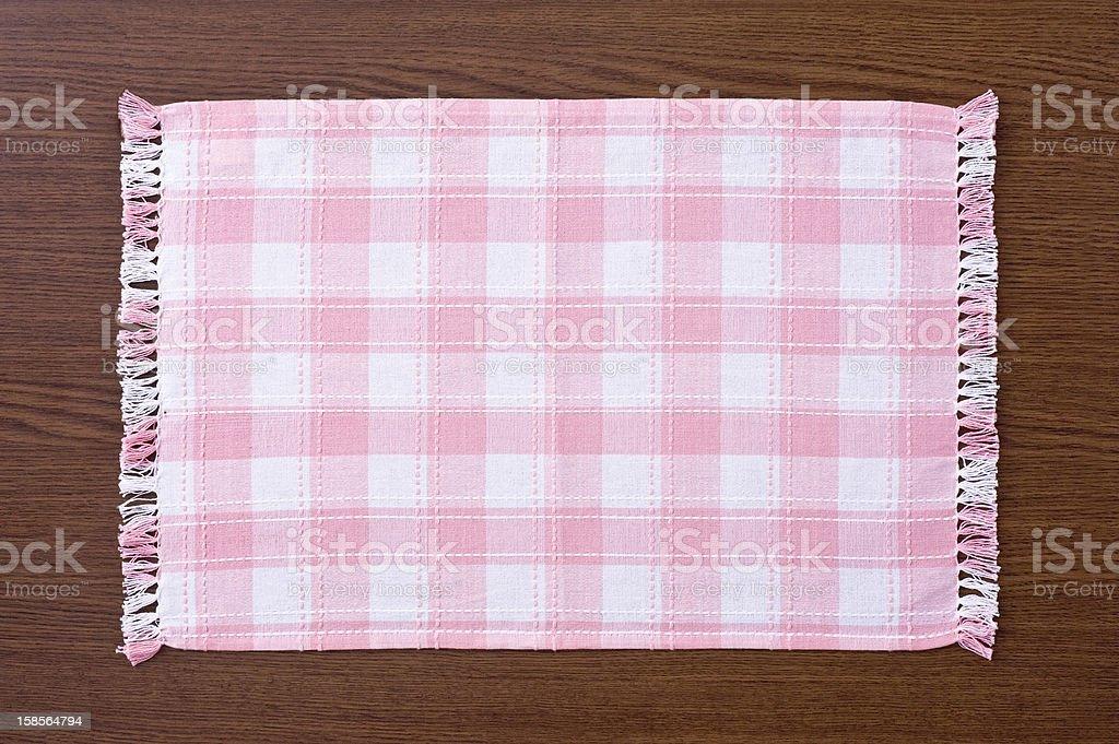 Pink plaid kitchen mat stock photo