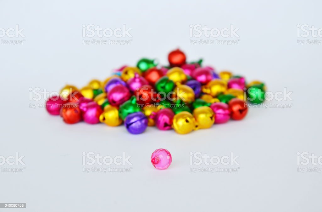 pink plastic bead and colorful bell stock photo