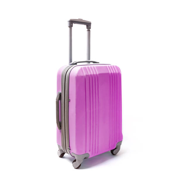 Pink plastic handluggage suitacase for travel isolated on white stock photo