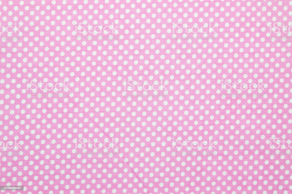pink polka dot fabric stock photo