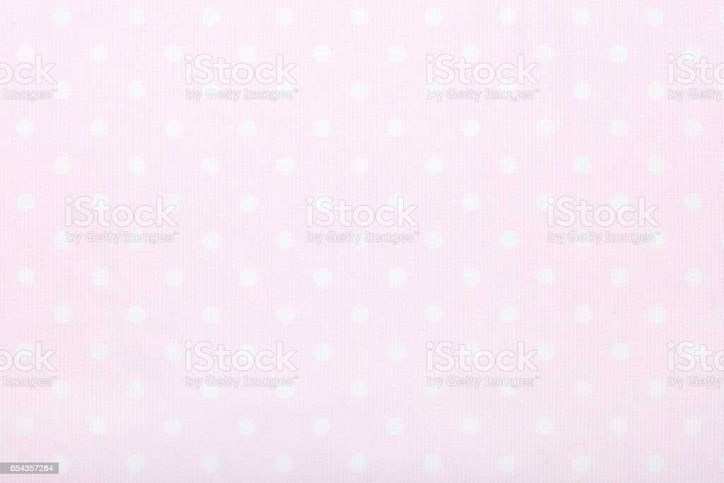 Pink polka dot fabric texture background stock photo
