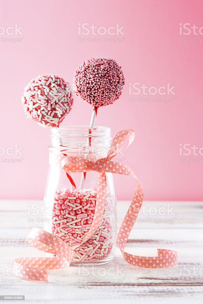 Pink pop cakes in a glass jar stock photo