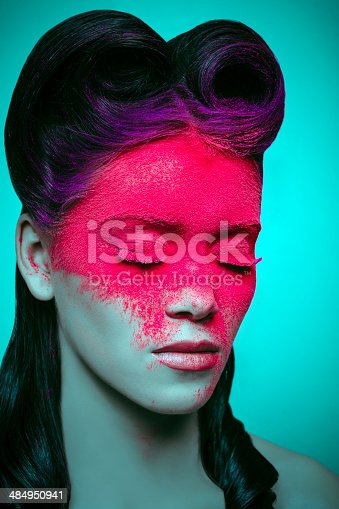 woman portrait with retro hairstyle and magenta powder makeup on her face.
