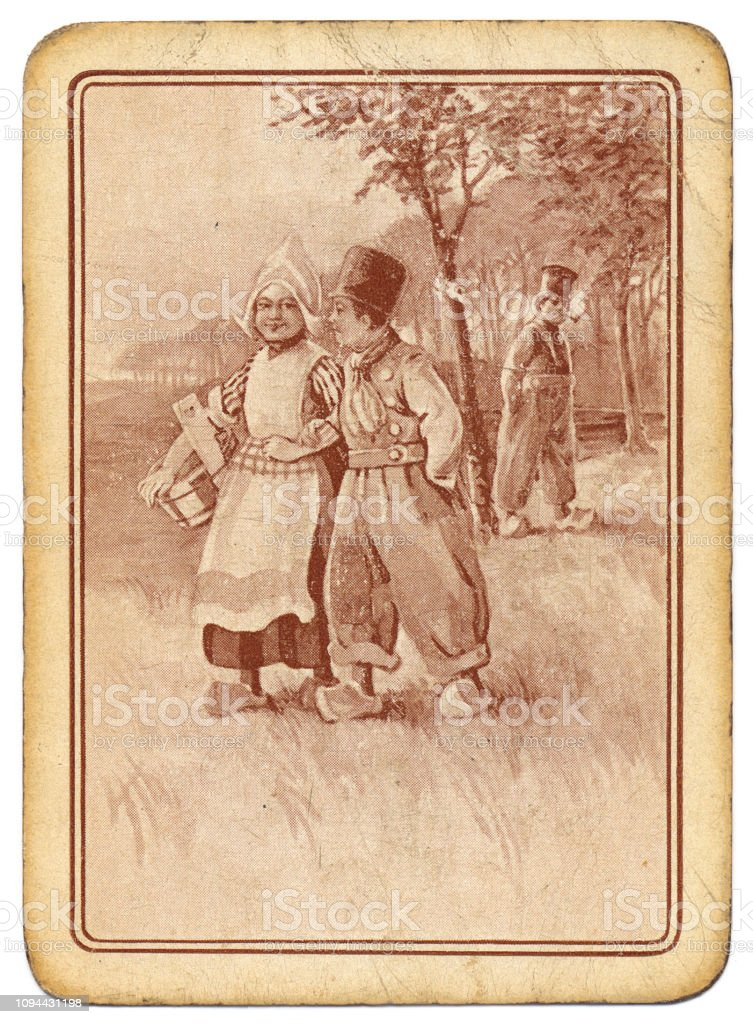 Pink puce back design antique charming Dutch couple in clogs stock photo