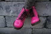 Pink punk alternative girl or woman shoes - cross legged