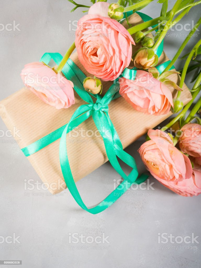 Beautiful Pink ranunculus flowers bouquet and gift box. Valentine...