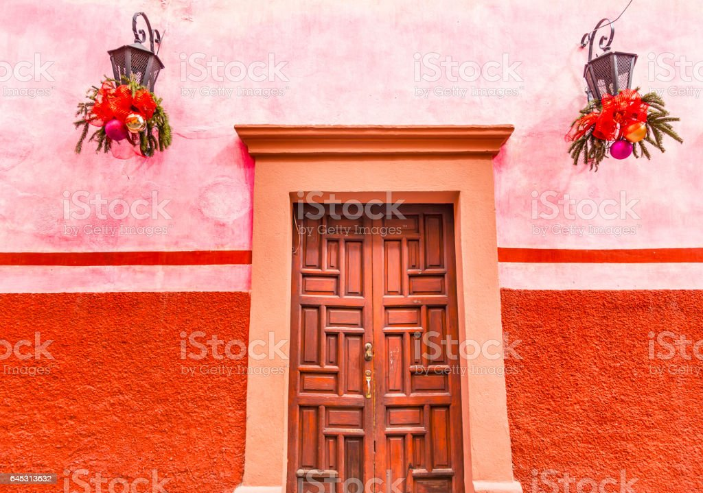 Pink Red Wall Brown Door Christmas San Miguel Allende Mexico stock photo