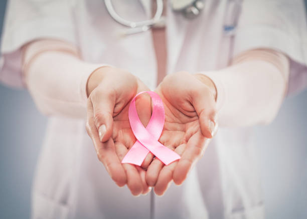 pink ribbon concept. national cancer survivor day. - ovarian cancer ribbon stock pictures, royalty-free photos & images