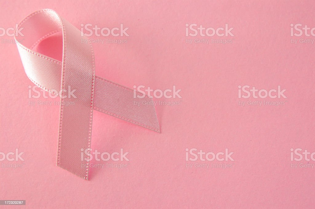 A pink ribbon representing breast cancer awareness royalty-free stock photo