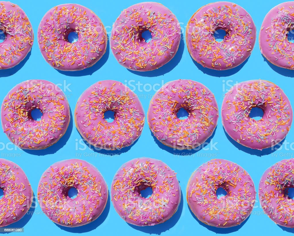 Pink ring doughnuts on blue background stock photo
