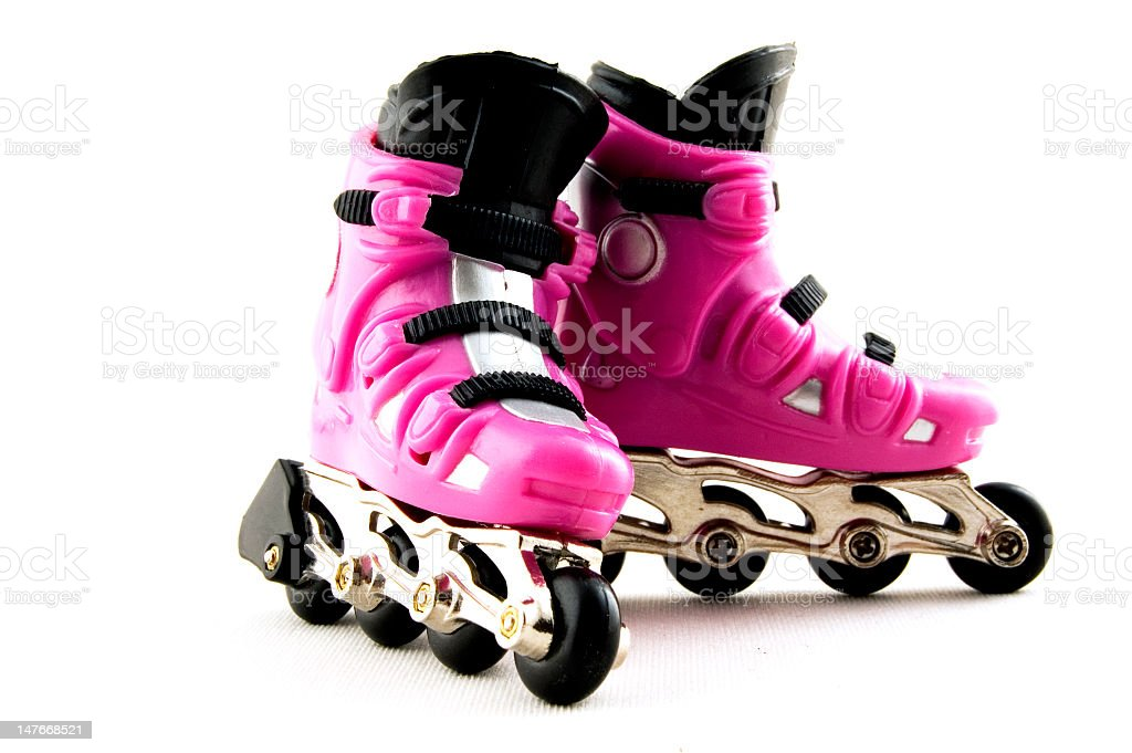 Pink rollerskates on white background royalty-free stock photo