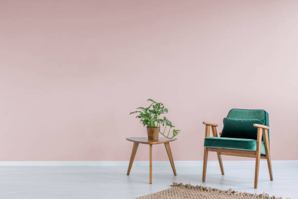 pink room with green armchair - retro decor stock photos and pictures
