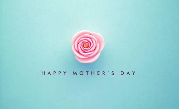 Rosa Rose und glücklich Muttertag Nachricht auf Petrol Hintergrund – Foto