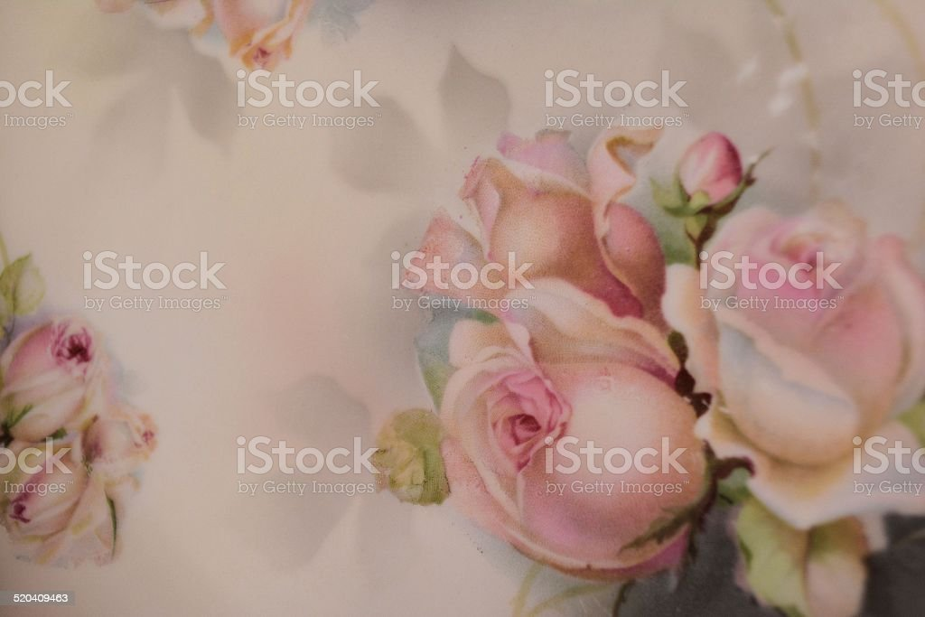 Pink Rose Buds on Antique Plate stock photo