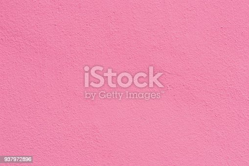 939873258 istock photo Pink rose cement plaster wall texture background. 937972896