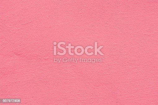 939873258 istock photo Pink rose cement plaster wall texture background. 937972908