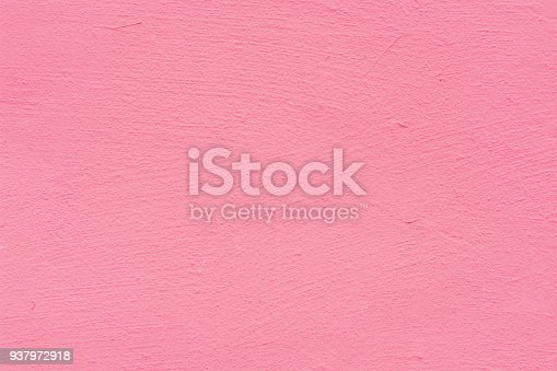 939873258 istock photo Pink rose cement plaster wall texture background. 937972918