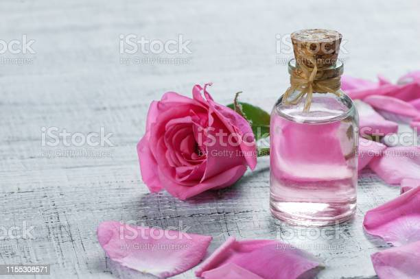 Pink rose flower and glass of bottle essential oil or rose water with picture id1155308571?b=1&k=6&m=1155308571&s=612x612&h=xymdpn verezoqqzbqqjnmbovky2v2btxonxhnhooji=