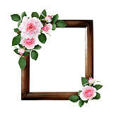 istock Pink rose flowers and green leaves in a corner floral arrangements on brown wooden frame 1019956300