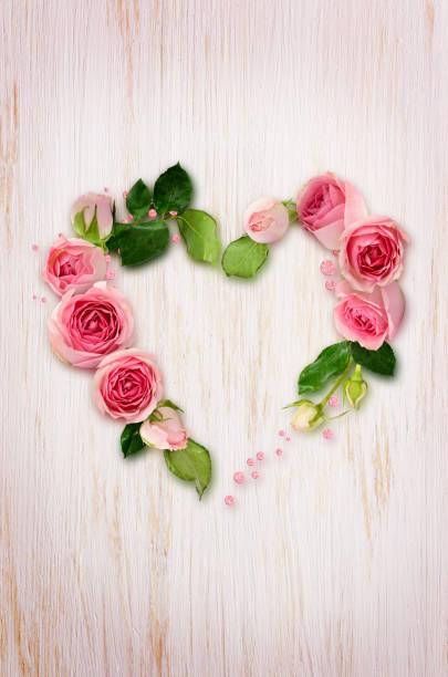 Pink rose flowers buds and glitter confetti in a heart shape on picture id1192225451?b=1&k=6&m=1192225451&s=612x612&w=0&h=ngb06cnqu iyengflri3p04gvtndbk6r1nugrhba2hy=