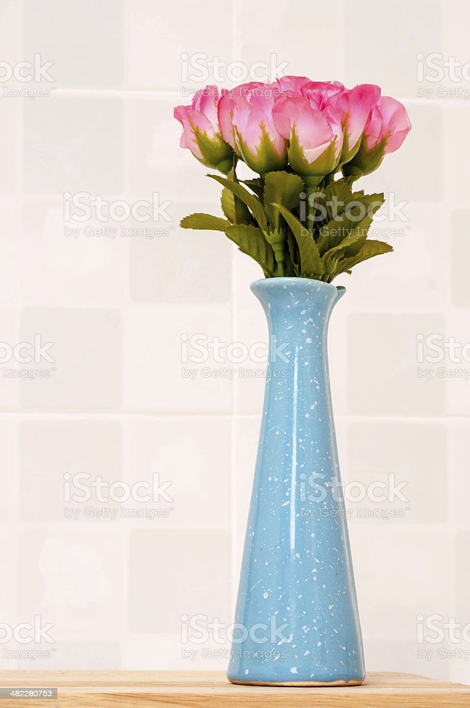 Pink rose on blue jar. stock photo