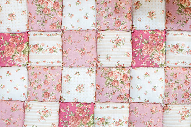 pink rose quilt background - quilt stock photos and pictures