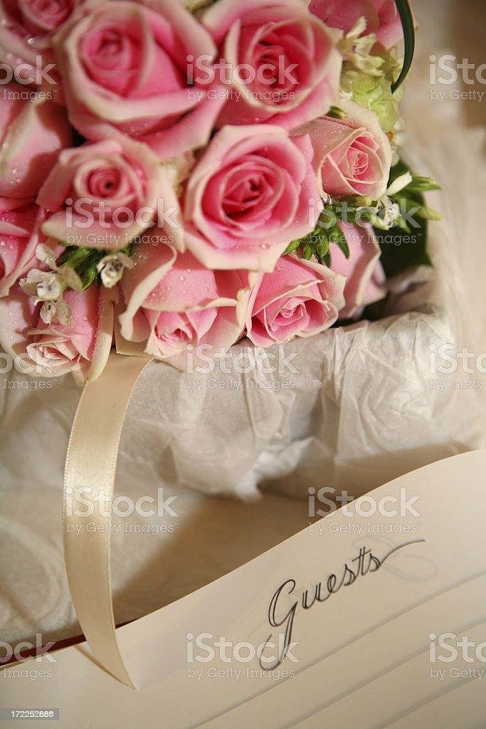 pink rose with guestbook royalty-free stock photo