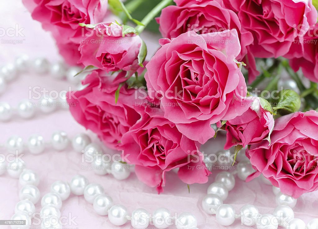 Pink roses and pearls stock photo