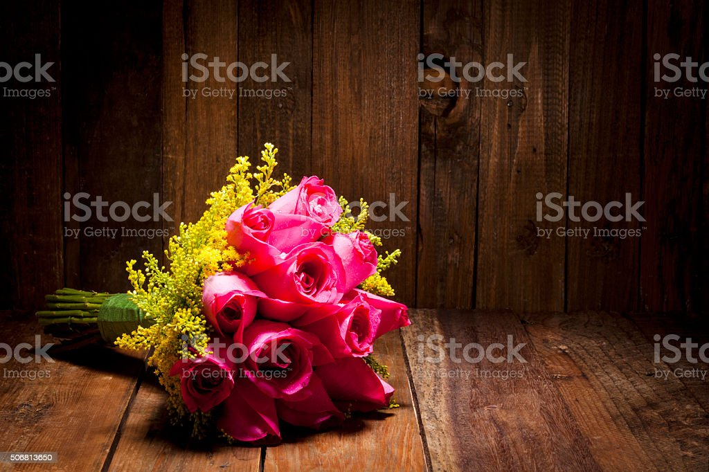 Pink roses bouquet on dark wood table stock photo