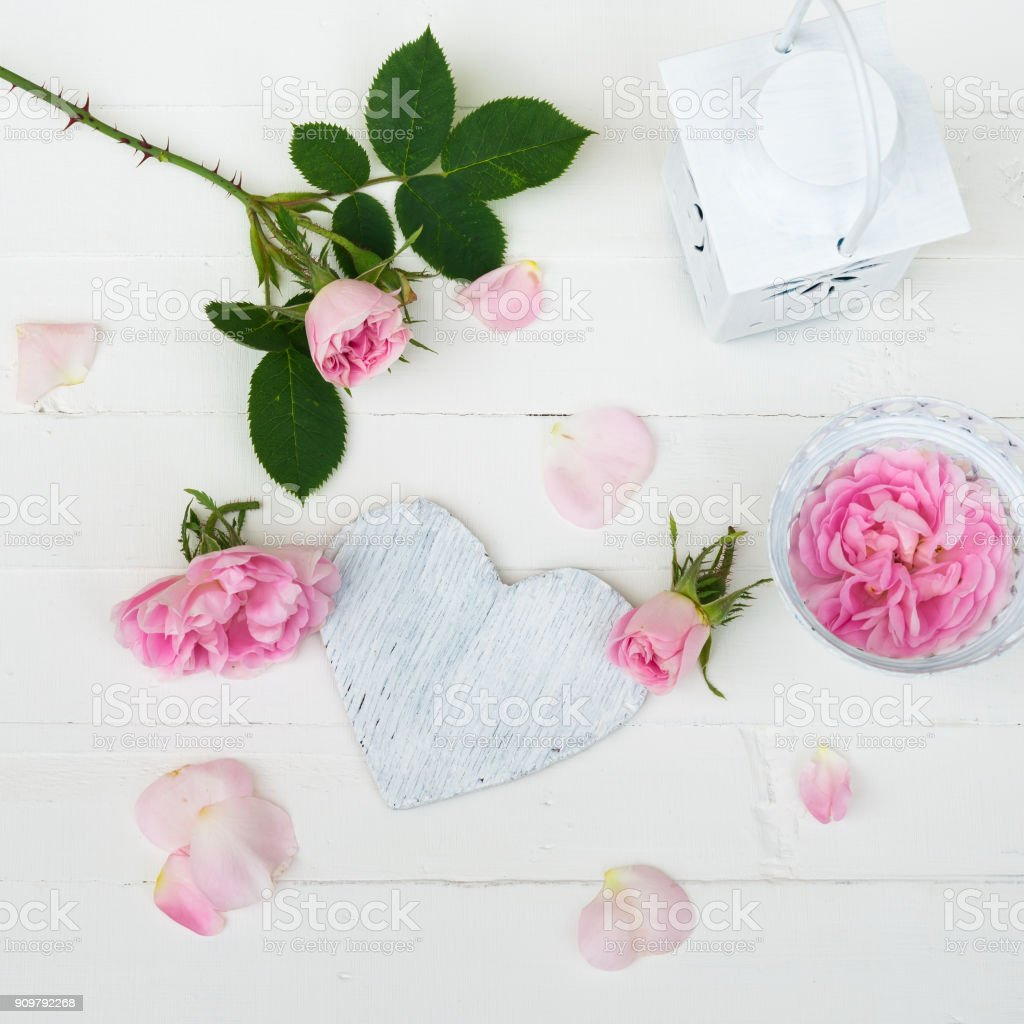 Pink Roses Flowers Rose Petals Wooden Heart On White Wooden Table