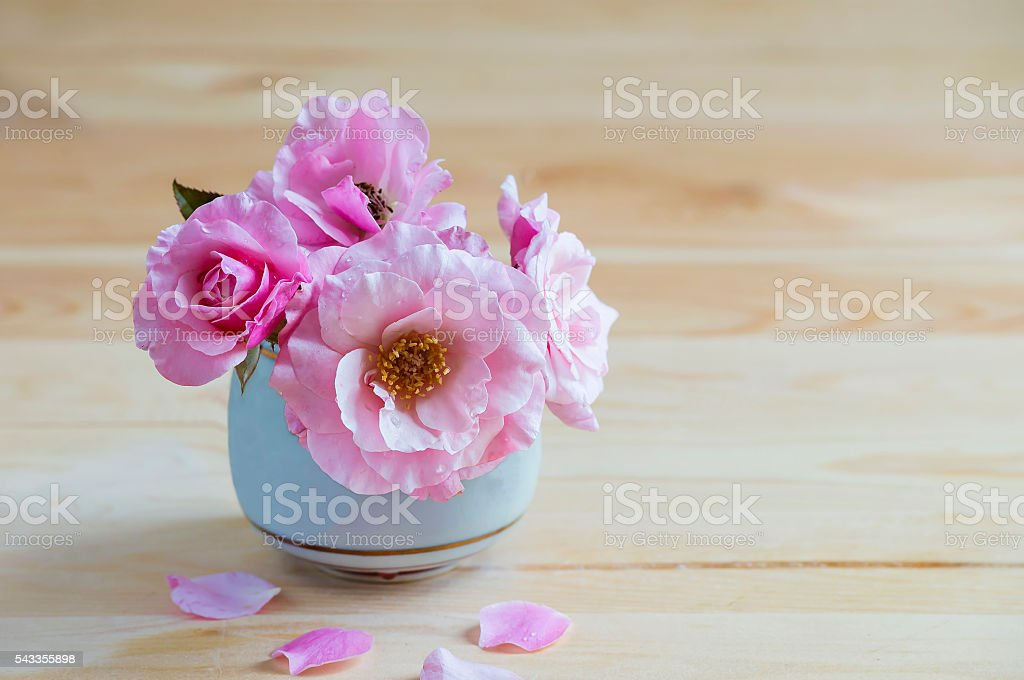 Pink roses in a vase on the table. stock photo