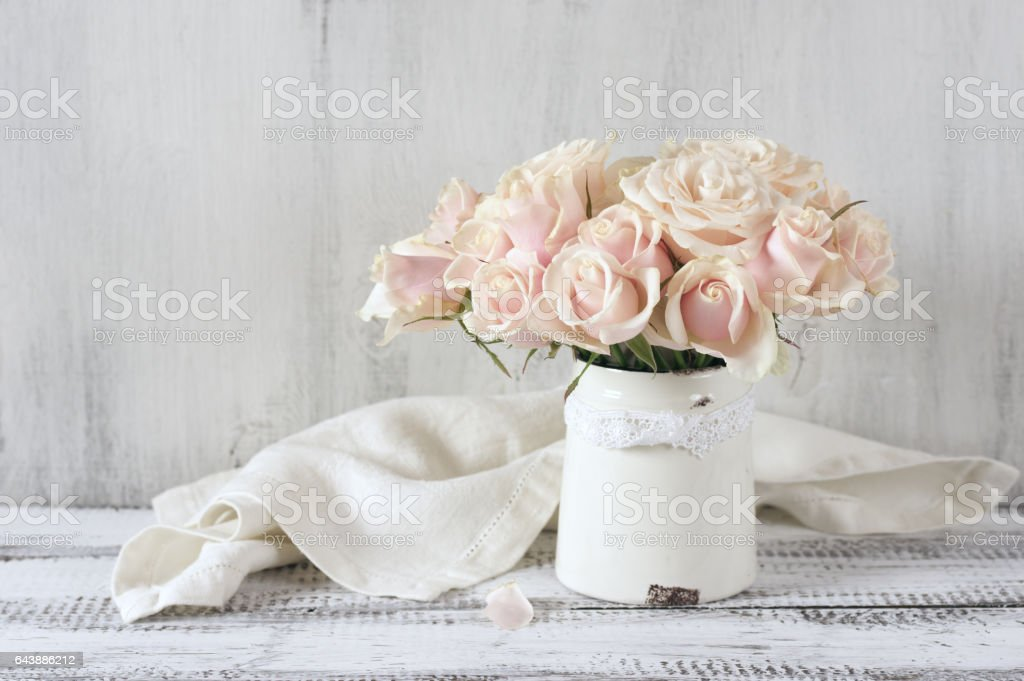 Pink roses in vintage vase stock photo