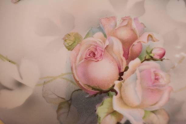 Pink Roses on an antique plate stock photo
