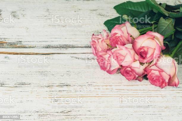 Pink roses on vintage wooden background picture id690610880?b=1&k=6&m=690610880&s=612x612&h=  lymaewezcbz5nd4ubgvdlxwurxjpmj9ifo1jjpba0=