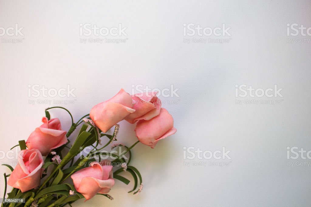 Pink roses on watercolor paper. Flat lay table with gentle floral ornament. stock photo